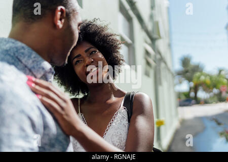 Affectionate young couple facing each other - Stock Photo