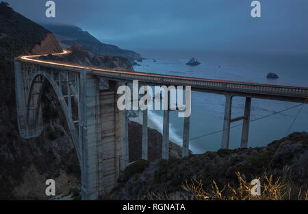 USA, California, Big Sur, Pacific Coast, National Scenic Byway, Bixby Creek Bridge, California State Route 1, Highway 1 in the evening - Stock Photo