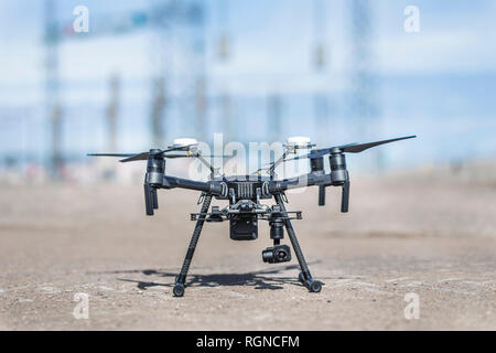 Drone landed after performing thermal analysis of Solar Energy Plant with visual and thermal camera. UAV are used for easy aerial inspections - Stock Photo