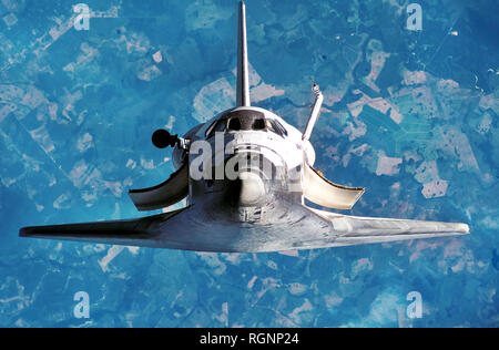 Spaceship on the flight. Space shuttle close-up. View of the planet Earth  from outer space. Some elements of this image are furnished by NASA - Stock Photo
