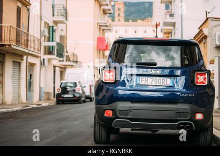 Terracina, Italy - October 15, 2018: Blue Jeep Renegade Bu/520 Car Parking At Street. Back View - Stock Photo