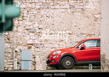 Terracina, Italy - October 15, 2018: Red Color Fiat 500X Car Parked On Background Old Wall. - Stock Photo