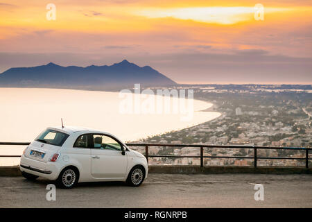 Terracina, Italy - October 15, 2018: White Color Fiat 500 Facelift 2016 Car Parked On Background Circeo Promontory And Tyrrhenian Sea In Sunset Or Sun - Stock Photo
