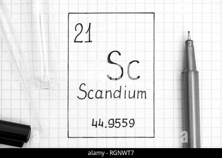 The Periodic table of elements. Handwriting chemical element Scandium Sc with black pen, test tube and pipette. Close-up. - Stock Photo