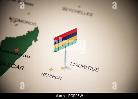 Mauritius marked with a flag on the map - Stock Photo