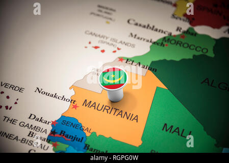 Mauritania marked with a flag on the map - Stock Photo