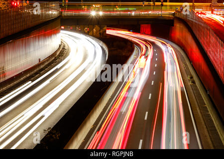 Essen, North Rhine-Westphalia, Ruhr area, Germany - Blue environmental zone, motorway A40 in the city centre of Essen at the end of the working day tr - Stock Photo