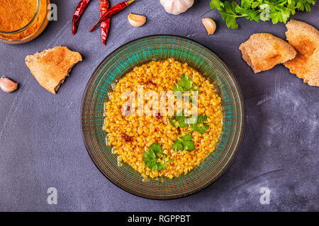 Lentil soup (Masoor Dal or Dal Tadka Curry), vegetarian, vegan cuisine. - Stock Photo