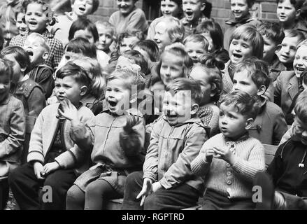 Children as spectators at the puppet theatre, 1961, Leipzig, Saxony, GDR, Germany - Stock Photo