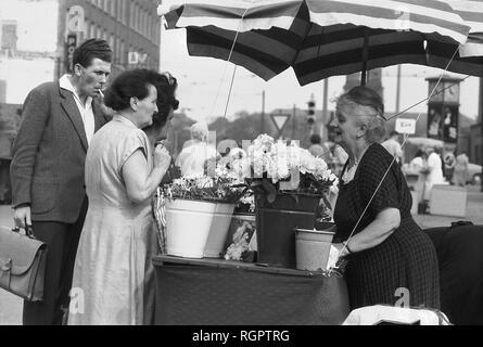 Flower sale, street scene 1961, Karl-Marx-Platz today Augustusplatz, Leipzig, Saxony, GDR, Germany - Stock Photo