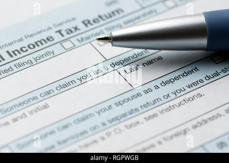 United States federal income tax return IRS 1040 document - Stock Photo