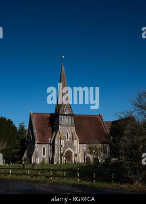 English country church with spire against blue sky. St James Barkham - Stock Photo