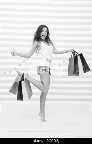 Woman carries bunch shopping bags striped background. Finally bought favorite brand. Tips shop sales. Girl satisfied shopping. Profitable purchase black friday. Too many packages to hold by only hand. - Stock Photo