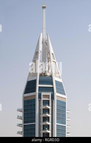 DUBAI, UAE - February 16, 2018: Top of The 23 Marina Tower, a 89 story residential skyscraper in the Dubai Marina area of Dubai, UAE - Stock Photo