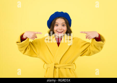 Place for ad advertisement. Child promoting something yellow background. Girl pointing index fingers herself. Advertising product. Look at this. Advertisement launching product. Advertisement concept. - Stock Photo