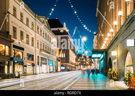 Helsinki, Finland. Night View Of Aleksanterinkatu Street With Railroad In Kluuvi District In Evening Christmas Xmas New Year Festive Illumination. - Stock Photo