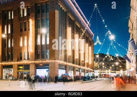 Helsinki, Finland. Building Of Department Store On Aleksanterinkatu Street In Evening Or Night Christmas Xmas New Year Festive Illumination. - Stock Photo