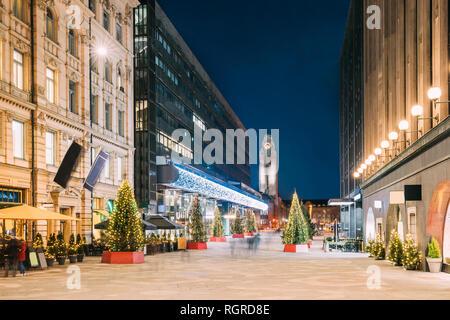 Helsinki, Finland. Night View Of Keskuskatu Street In Evening Christmas New Year Xmas Festive Illumination. Shopping Mall And Helsinki Central Railway - Stock Photo