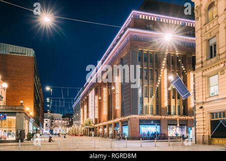 Helsinki, Finland. Building Of Department Store On Keskuskatu Street In Evening Or Night Christmas Xmas New Year Festive Illumination. - Stock Photo