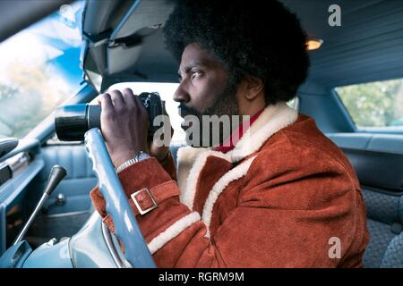 John David Washington Film: Blackkklansman (USA 2018)  Character(s): Ron Stallworth  / Literaturverfilmung (Based On The Autobiographical Book By Ron Stallworth) Director: Spike Lee 14 May 2018  SAW90772 Allstar Picture Library/BLUMHOUSE PRODUCTIONS  **Warning**  This Photograph is for editorial use only and is the copyright of BLUMHOUSE PRODUCTIONS  and/or the Photographer assigned by the Film or Production Company & can only be reproduced by publications in conjunction with the promotion of the above Film. A Mandatory Credit To BLUMHOUSE PRODUCTIONS is required. The Photographer should also  - Stock Photo