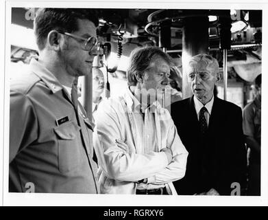 CAPE CANAVERAL, Fla. (May 27, 1977) Lt. Cdr. Robert J. Labrecque, executive officer, left, President Jimmy Carter and Adm. Hyman G. Rickover, Retired, Director, Division of Naval Reactors, U.S. Energy Research and Development Administration and Deputy Commander for Nuclear Propulsion, are in the control room on board the nuclear powered submarine USS Los Angeles (SSN 688) during a cruise. (U.S. Navy photo by Senior Chief Journalist Archie N. Galloway/Released) - Stock Photo