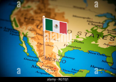 Mexico marked with a flag on the map - Stock Photo