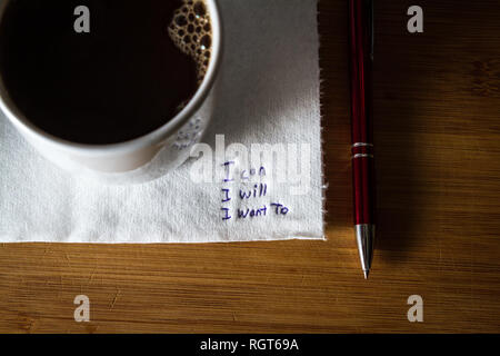 hand written note on a coffee stained napkin with an empowering message, I can I will I want to. - Stock Photo