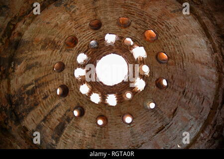 Interior view of an old and dilapidated Turkish bath dome. - Stock Photo