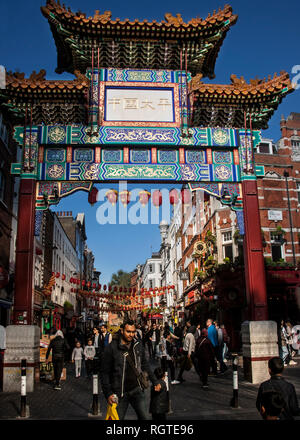 wooden painted paifang entrance to chinatown dean street soho london - Stock Photo
