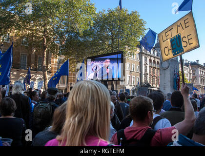 Sadiq Khan on tv screen at people's vote march London - Stock Photo