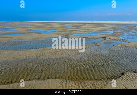 Wadden sea sand shaped by wind and tidal currents, Schleswig-Holstein Wadden Sea National Park, Westerhever, Schleswig-Holstein, Germany - Stock Photo