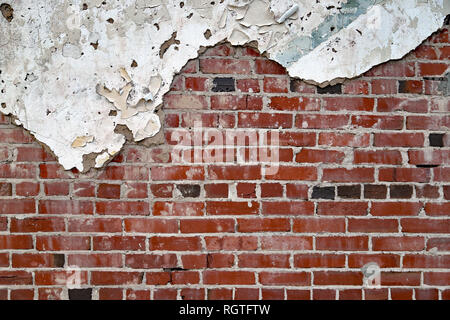 Old Vintage painted Brick and mortar wall with plaster and pealing paint, background texture - Stock Photo