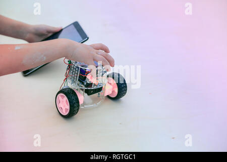 Assembled all-terrain vehicle, robotic toy, controlled by a tabl - Stock Photo
