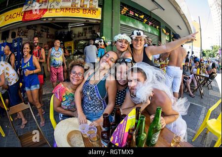 South America, Brazil - February 19, 2017: Friends having great fun during pre-Carnival festivities in downtown Rio de Janeiro. - Stock Photo