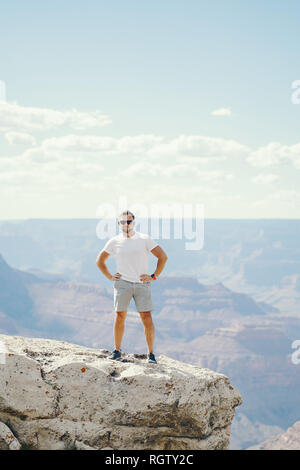man exploring the grand canyon in Arizona during the summer - Stock Photo