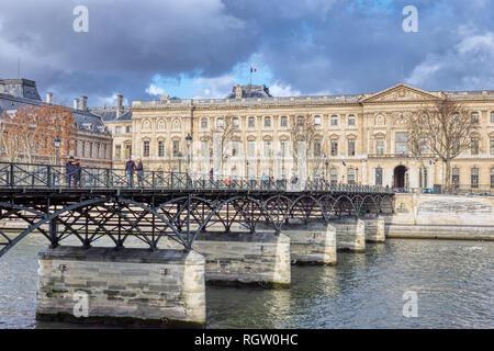 People walking on Pont des Arts - Paris, France - Stock Photo