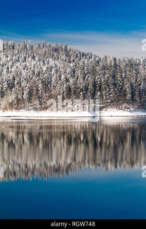 Gorski kotar, Lokvarsko lake in Croatia, beautiful landscape in winter, forest reflecting in the water - Stock Photo