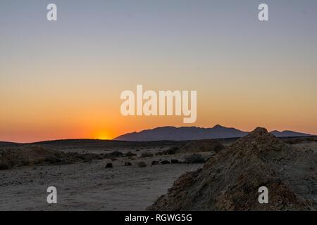 rugged desert mountain landscape sunset - Stock Photo