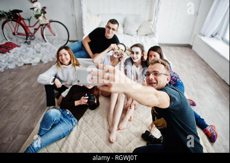 Group of people making selfie. Team photographer, designers and models stuff on photosession, master class of proffesionals. - Stock Photo