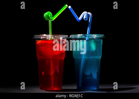 blue and red iced tea on a black background - Stock Photo