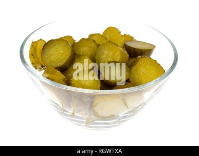 Bowl of chopped pickled cucumber isolated on white background. Studio Photo - Stock Photo