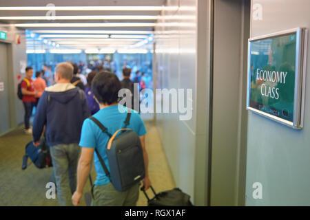 SINGAPORE - CIRCA NOVEMBER, 2015: passengers exit a Singapore Airlines Airbus A380-800 aircraft at Changi Airport. - Stock Photo