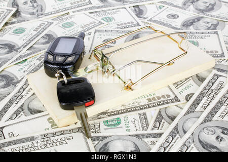 Car keys and money with mousetrap