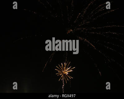 Fireworks on dark sky background - Stock Photo