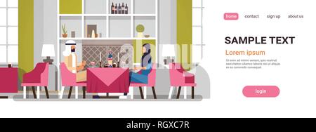 arabic couple sitting cafe table romantic dinner happy valentines day celebration concept arabic man woman love dating modern restaurant interior - Stock Photo