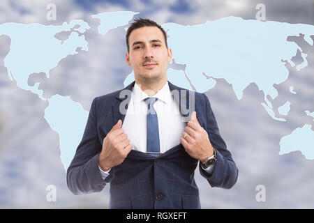 Hero-shot of male broker holding suit open showing tie in front of blue world map background - Stock Photo