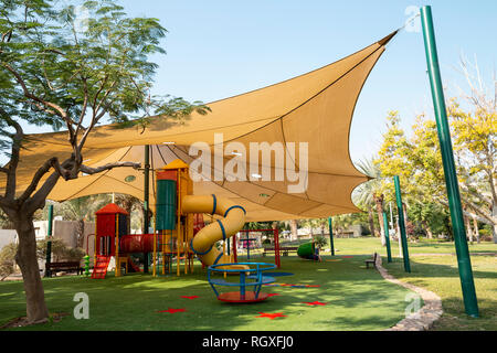 Shade structure on the playground safe for UV sun protection - Stock Photo