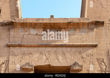 Detail of upper side of main entrance to temple of Horus at Edfu - Egypt - Stock Photo