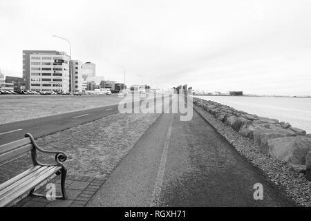 Reykjavik, Iceland - October 12, 2017: coastal landscape. Cross country traveling. Sea promenade roads on natural landscape. Enjoy traveling along sea side. Happiness is traveling. - Stock Photo