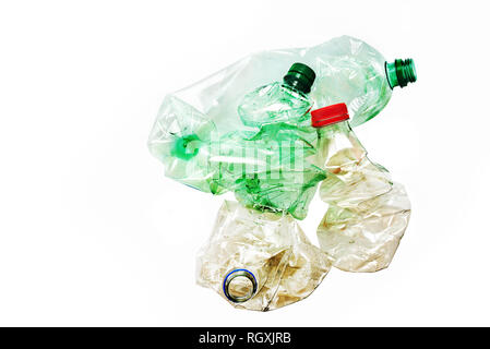 Dirty plastic bottles crushed and crumpled against isolated on the white background. Recycling concept - Stock Photo